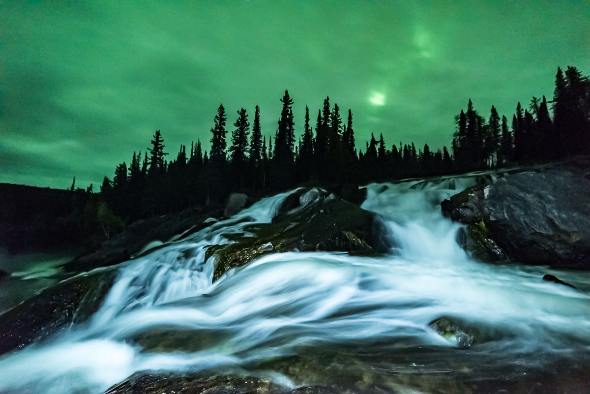Barbee_160903_8698 |  Cameron River Ramparts at night. Aurora lighting up an overcast night.